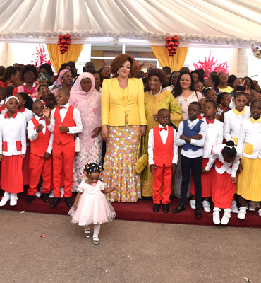 "Pupils of ""Les Coccinelles"" Light 2016 Christmas Tree with Mrs. Chantal BIYA"